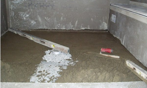 how to build a shower pan on a concrete floor