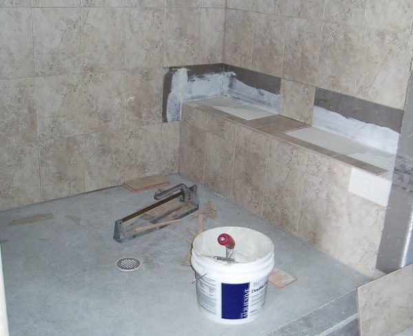 how to install a shower base on concrete floor