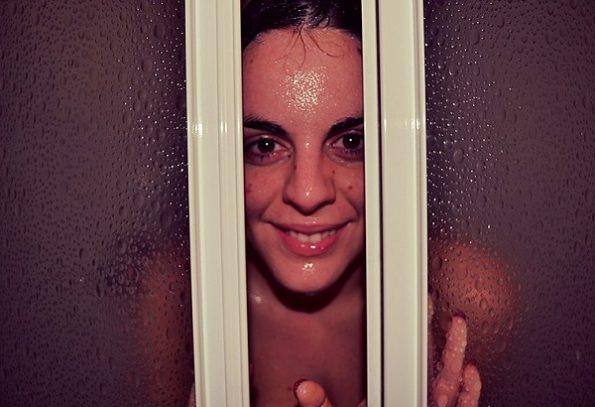 why do women take hot showers