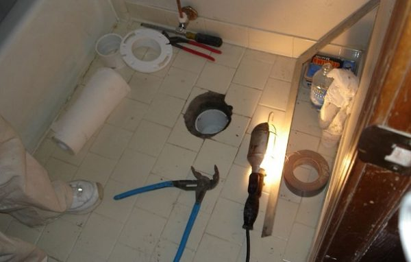 How to install a toilet flange in new construction on a tile floor